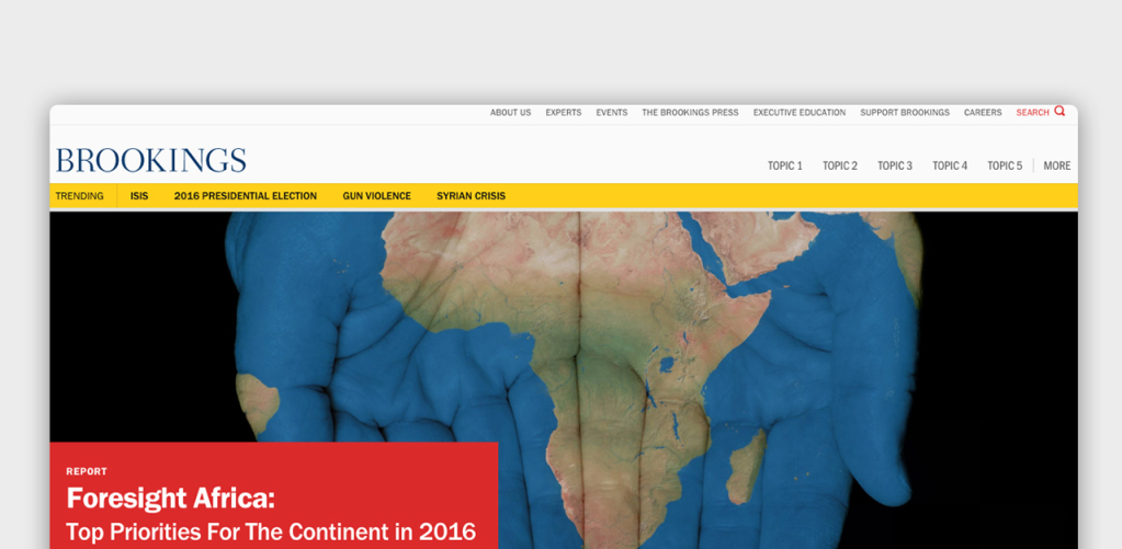 The front page of Brookings with a headline over an image of Africa overlaid on two outstretched hands