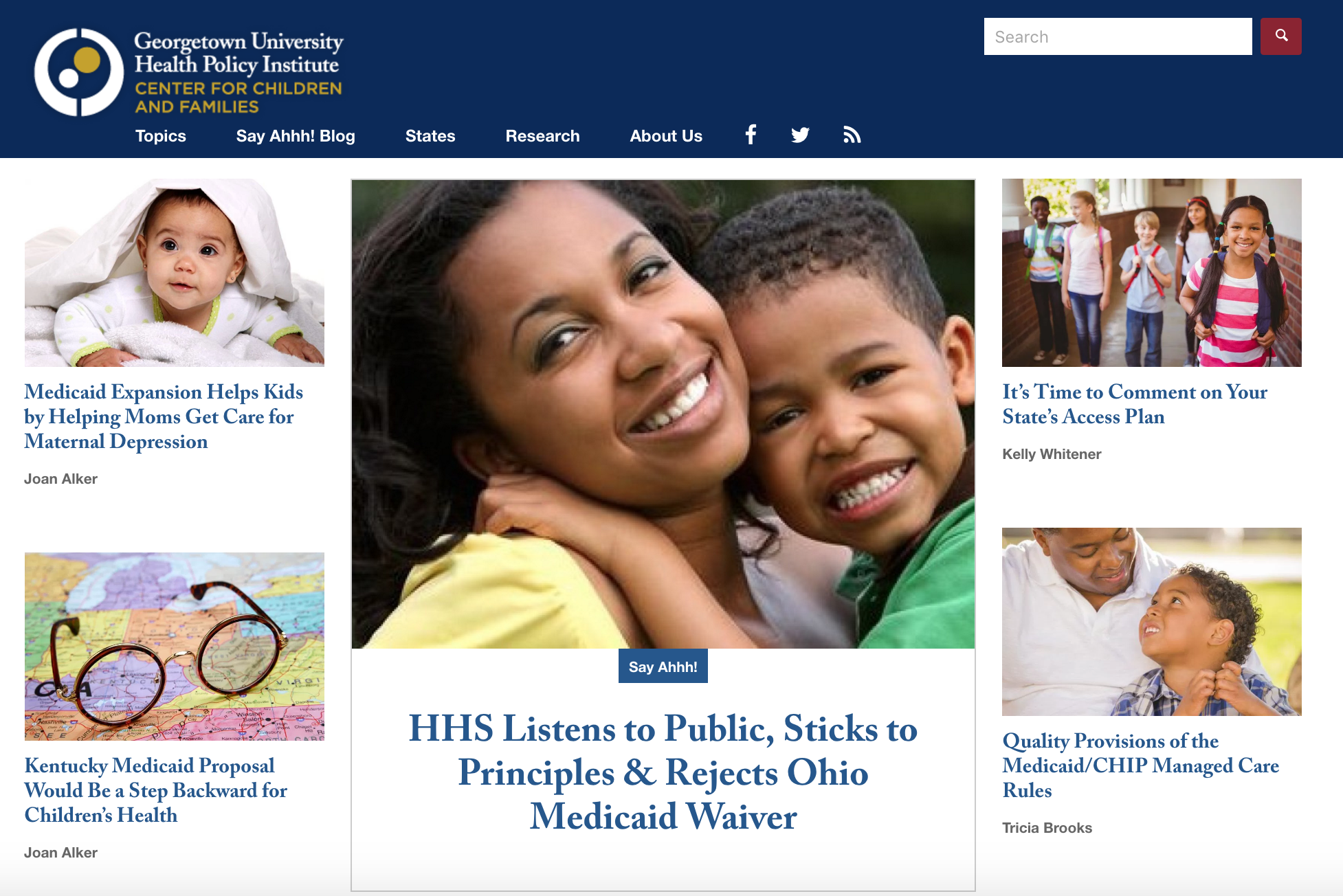 A screenshot of the Georgetown home page, with a blue header and navigation bar at the top, one main featured article and image in the middle of the page surrounded by four smaller articles and images
