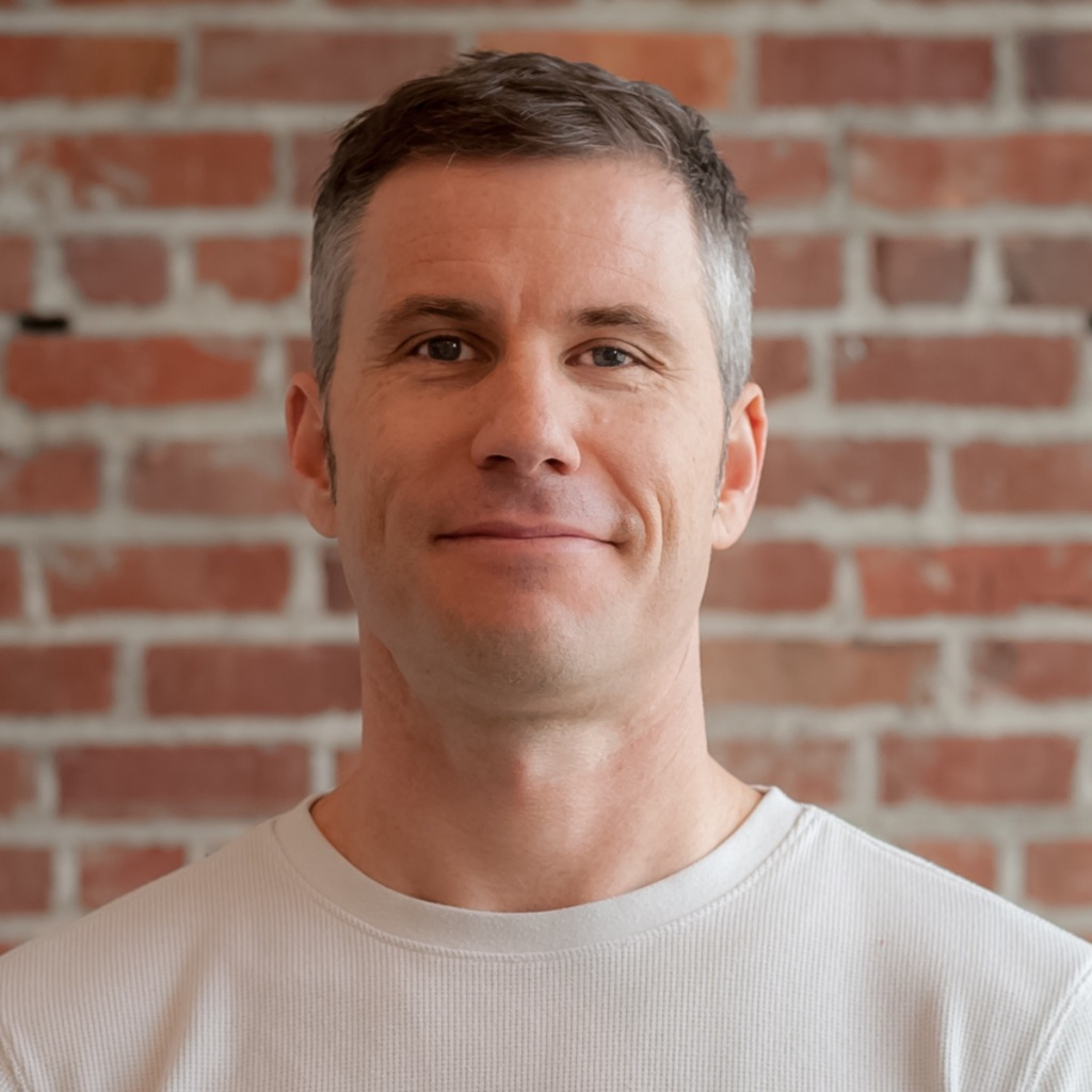 a headshot of Gabe Luethje, the writer of these particular perspectives on remote work