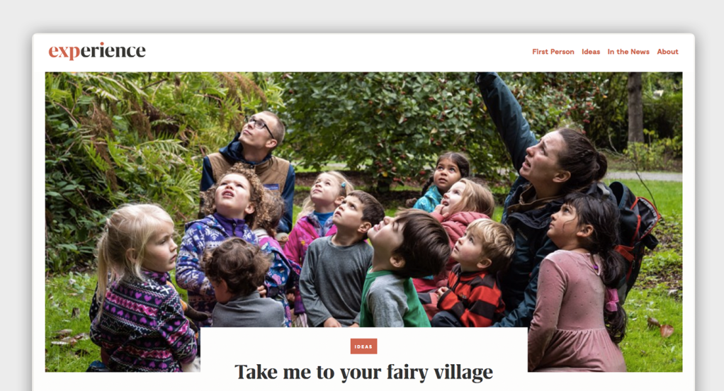 """The Experience Magazine website with a large photo of schoolchildren learning from a pointing teacher outside, with navigation above and the headline """"Take me to your fairy village"""" below"""