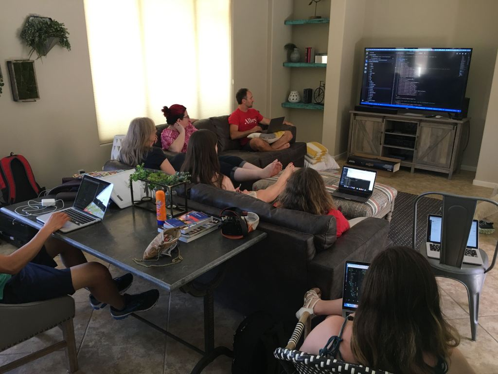 Here's Team VIP reviewing some code together in a cozy living room.