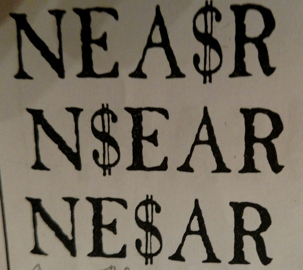 An image of a piece of paper with NEA$R on one line, N$EAR below it, and NE$AR on a final line
