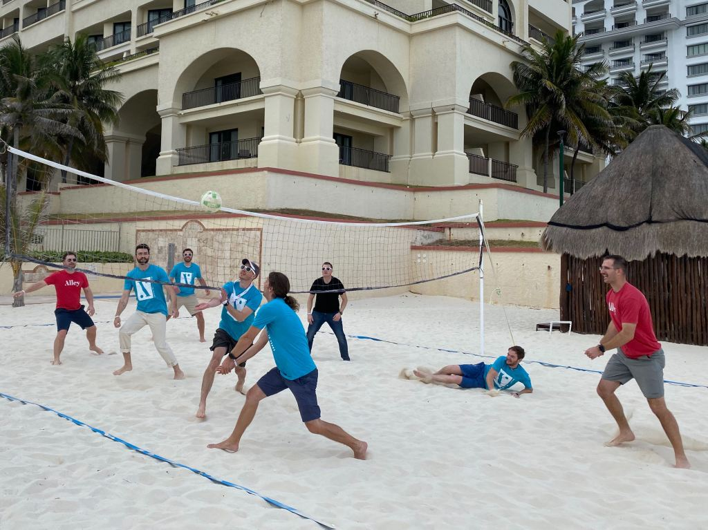 A volleyball game played between two teams of Alley team members.