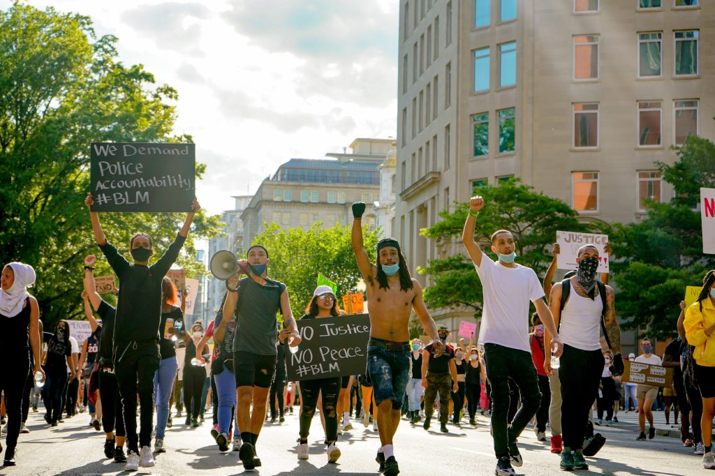 black lives matter protestors marching in the streets of washington d.c.