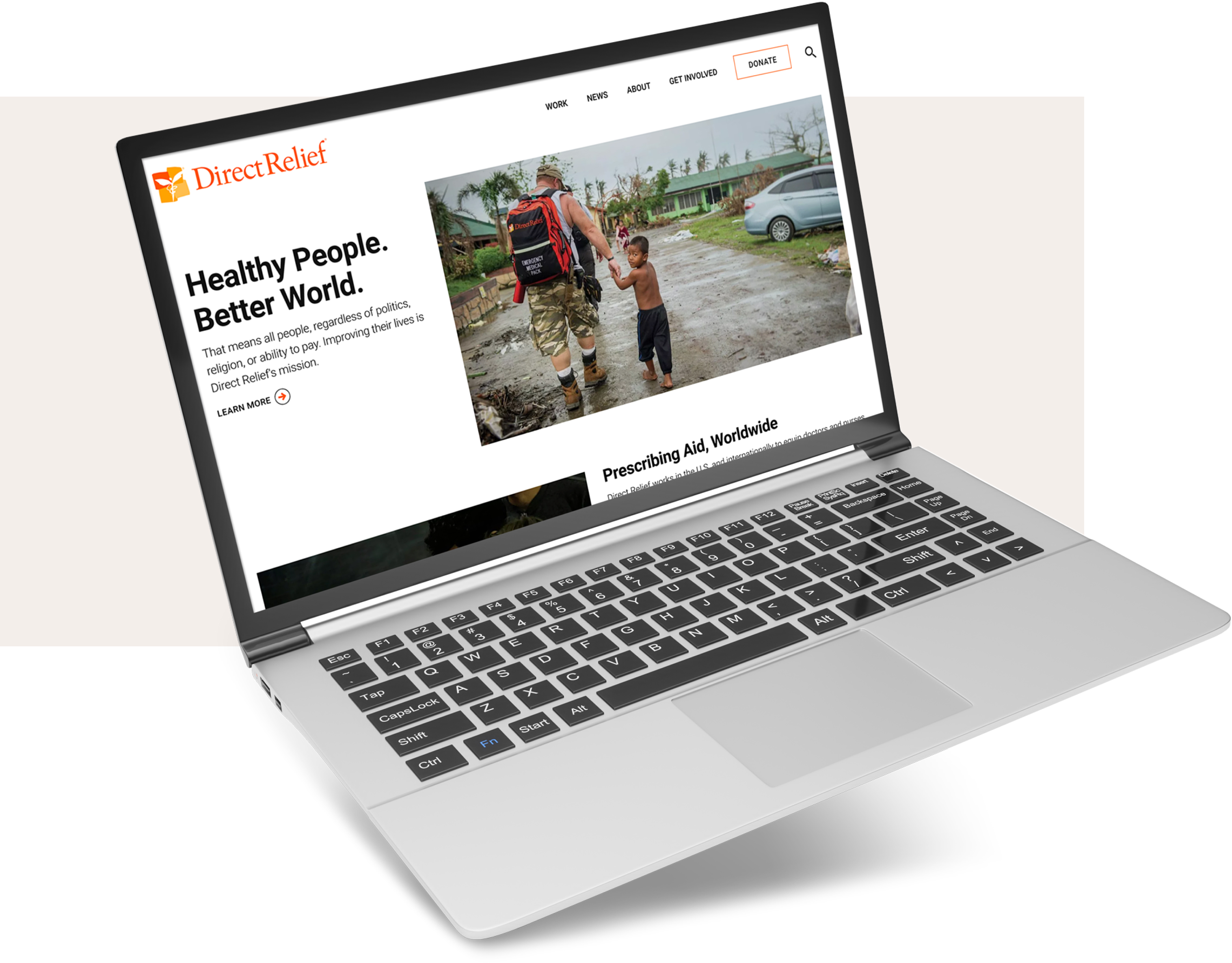 The Direct Relief homepage with a headline and image, displayed on a laptop screen